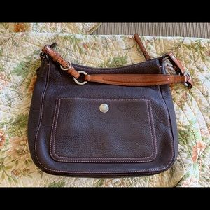 Brown leather coach bag with pink stitching